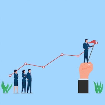 El hombre está parado en el borde del gráfico con la metáfora de la bandera de éxito y beneficio.