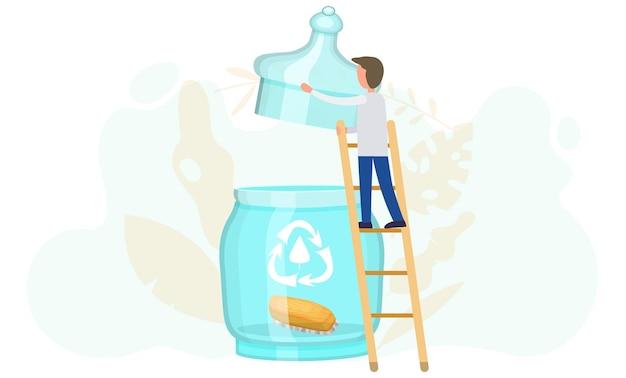 Un hombre de pie en una escalera levanta la tapa de un frasco de vidrio con un logotipo de reciclaje y un cepillo de madera para ropa adentro.
