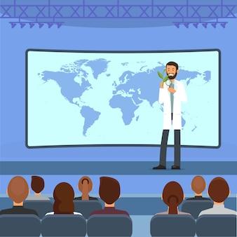 Hombre con planta en el escenario. dar una conferencia a la audiencia.