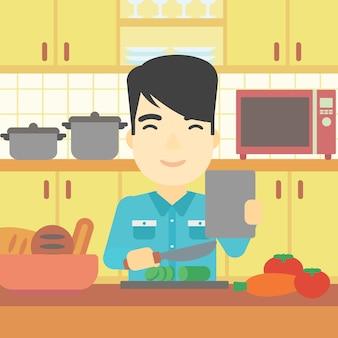 Hombre que cocina la ensalada de verduras saludables.