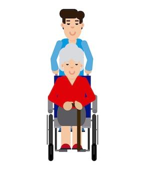 Hombre que cuida a una mujer mayor en una silla de ruedas