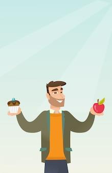 Hombre que elige entre la manzana y la magdalena.