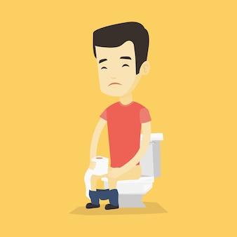 Hombre que sufre de diarrea o estreñimiento.