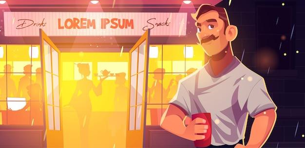 Hombre de recreación de bar con soporte de taza frente a pub