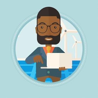 Hombre revisando paneles solares y turbinas eólicas