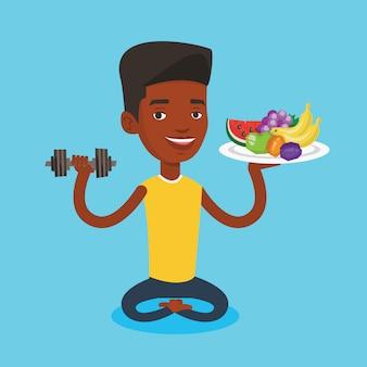 Hombre sano con frutas y pesas.