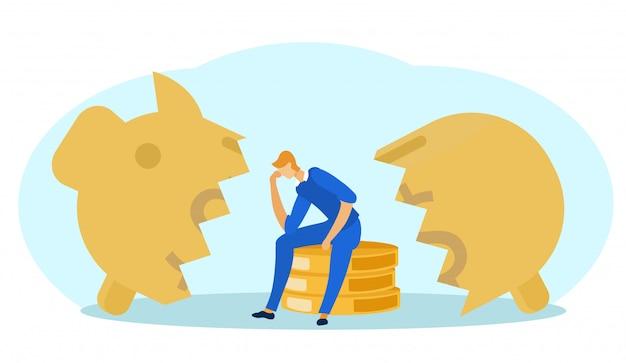Hombre sentado en la desesperación cerca de broken piggy bank.