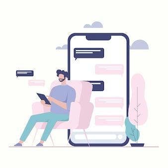El hombre se sienta con handphone. aplicación de chat chat de burbujas
