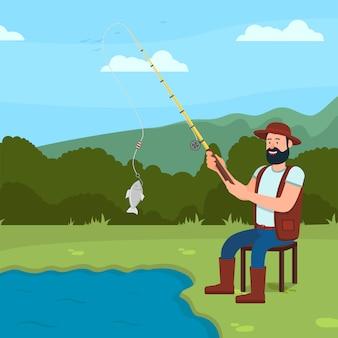 El hombre se sienta en la orilla del lago y fish¡atch fish. caña de pescar en la mano.