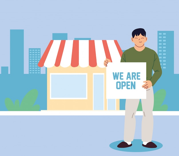 Hombre en su negocio local con banner abierto