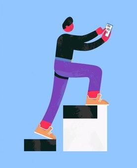 Hombre subiendo las escaleras, escribiendo mensajes en el teléfono inteligente