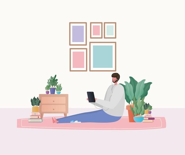 Hombre con tableta trabajando en el diseño de alfombras del tema trabajo desde casa