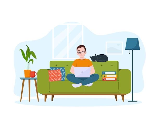 Un hombre trabaja en la computadora portátil en el sofá concepto de trabajo desde casa