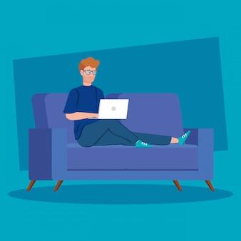 Hombre trabajando en teletrabajo con laptop en sofá