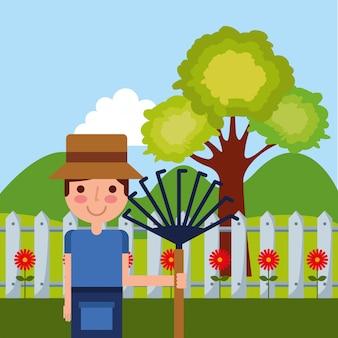 Hombre trabajo jardineria tiene horquilla flores arbol cerca montañas
