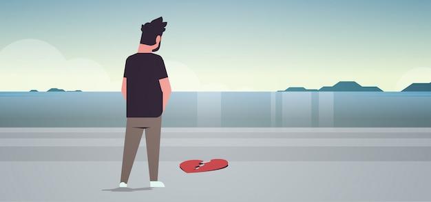 Hombre triste con el corazón roto en la depresión