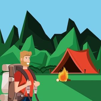 Hombre turista en zona de acampada