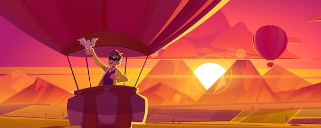 Hombre de viaje en globo aerostático con paloma en mano