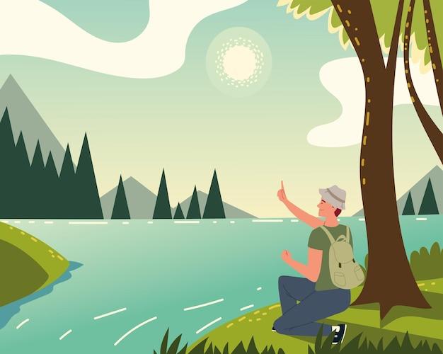 Hombre viajero en el río del bosque