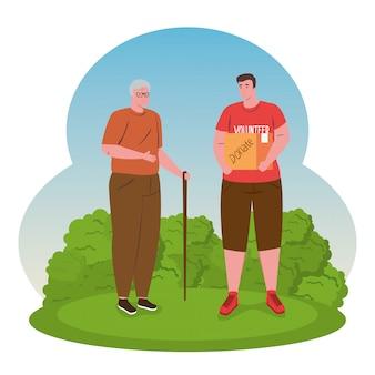 Hombre voluntario con caja de donación y abuelo