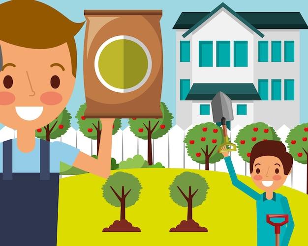 Hombre y niño en el jardín de la casa con pala y fertilizante