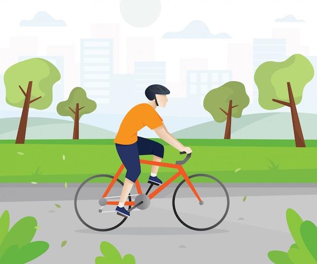 Hombres con bicicletas en el parque de la ciudad.