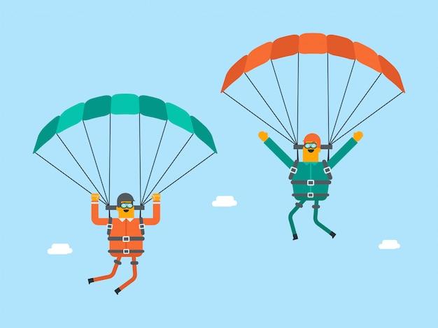 Hombres blancos caucásicos volando con un paracaídas.