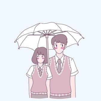 Hombres y mujeres jóvenes de pie con uniformes escolares y desplegando paraguas