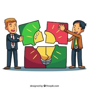 Hombres de negocios divertidos con piezas de puzle