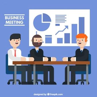 Hombres de negocios en una reunión con gráficas