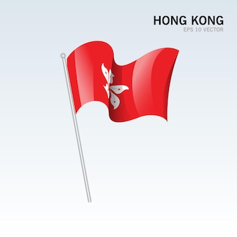 Hong kong ondeando la bandera aislado en gris