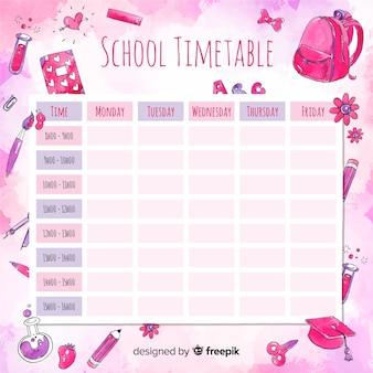 Horario escolar en acuarela con elementos