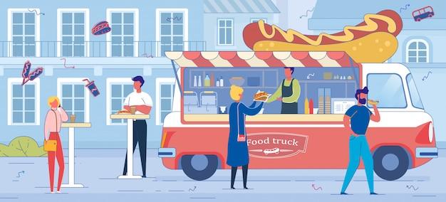 Hot dog truck y personas en el telón de fondo del paisaje urbano.