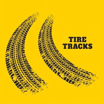 Huellas de neumáticos de camino imprime sobre fondo amarillo