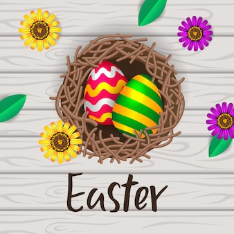 Huevo decorativo en el nido y mesa de madera.