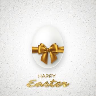 Huevo de pascua 3d realista con lazo dorado. vacaciones festivas de lujo.