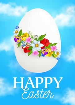 Huevo de pascua con flores de primavera, corona de narciso