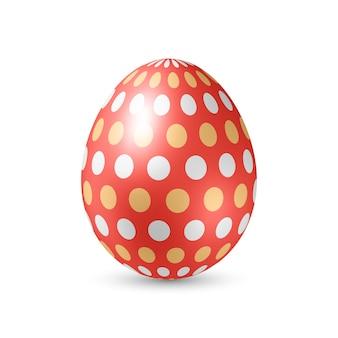 Huevo rojo con puntos de colores - de pie verticalmente sobre blanco