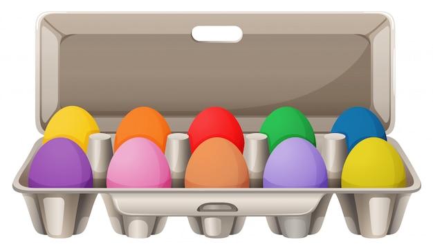 Huevos coloridos en cartón de huevos