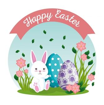 Huevos de pascua y conejo con plantas de flores