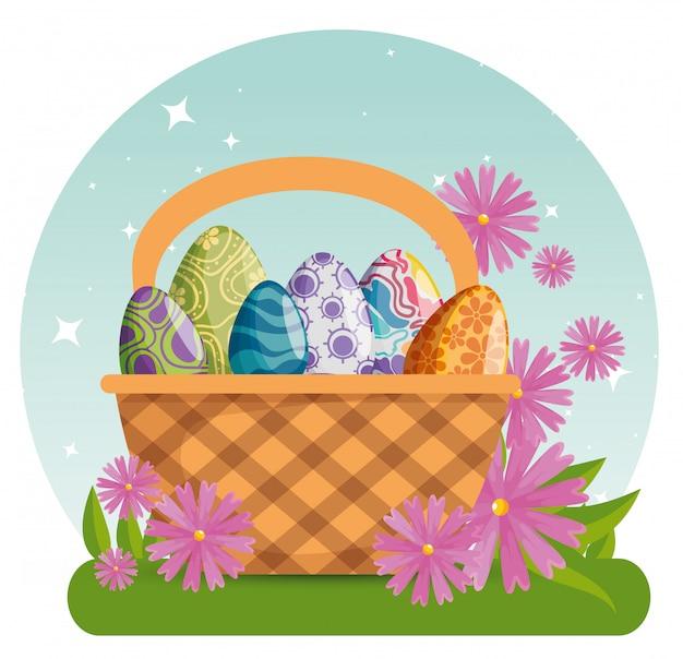 Huevos de pascua con decoración de figuras dentro de la canasta