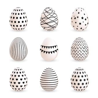 Huevos de pascua pintados modernos fijados en el fondo blanco