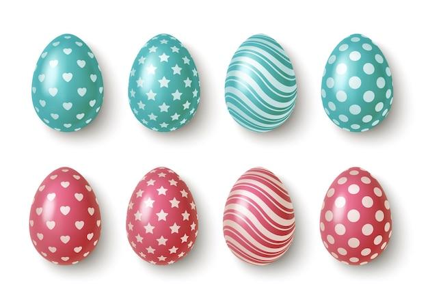 Huevos de pascua realistas de color rosa y azul con adornos geométricos