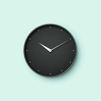 Icono de reloj negro con sombra sobre fondo de pared de menta
