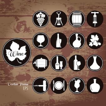 Iconos acerca del vino sobre un fondo de madera