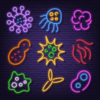 Iconos de letrero de neón de virus y bacterias