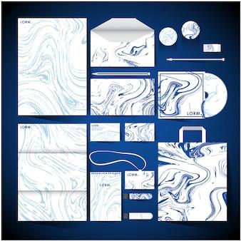 Identidad corporativa con diseño de mármol blanco y azul.