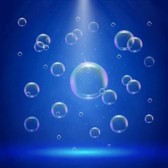 Iluminación escénica con focos y burbujas.