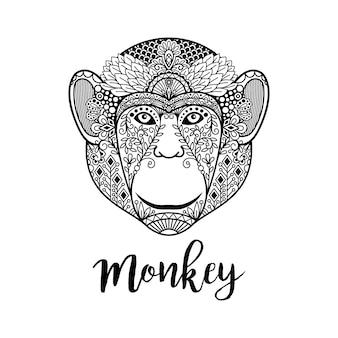 Ilustración de cabeza de mono con motivos étnicos.