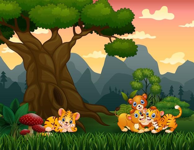Ilustración de cachorro de tigre y león jugando bajo el gran árbol